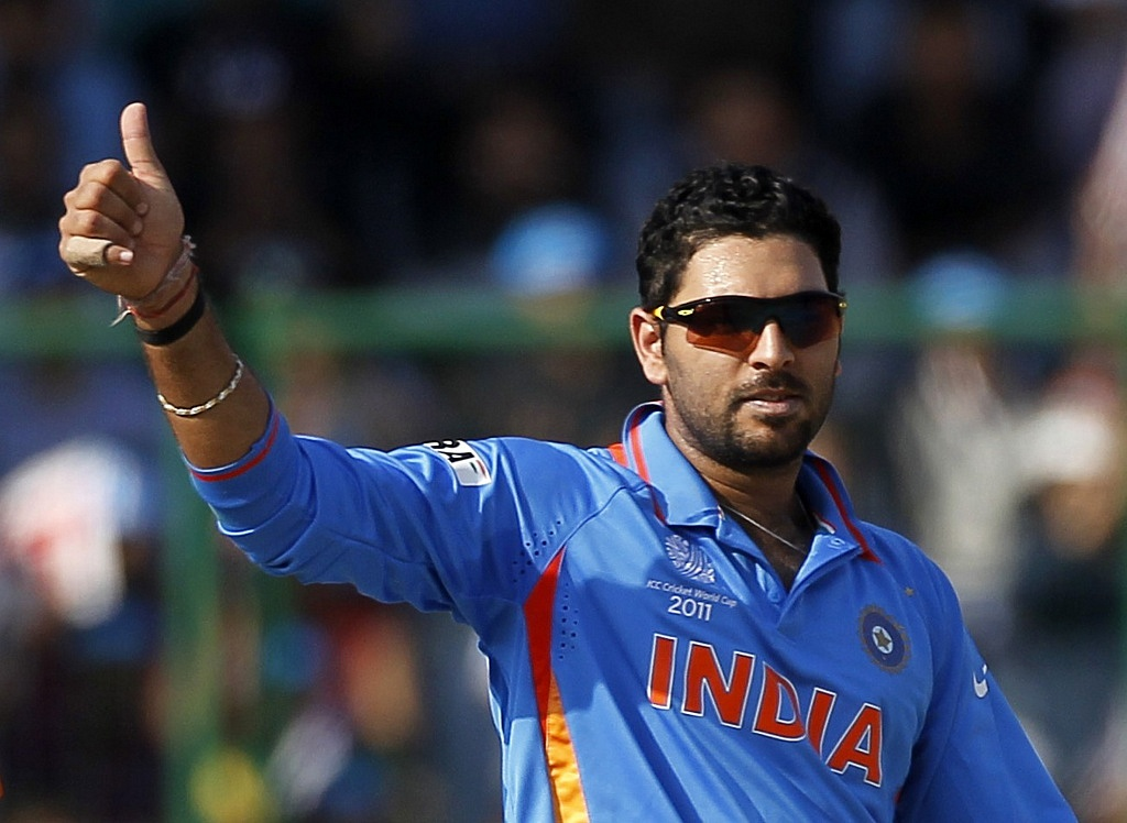 India's Yuvraj Singh celebrates taking the wicket of The Netherlands' Wesley Baressi during their ICC Cricket World Cup group B match in New Delhi March 9, 2011. REUTERS/Adnan Abidi (INDIA - Tags: SPORT CRICKET)