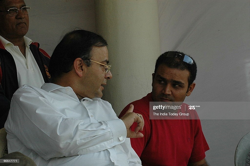 INDIA - FEBRUARY 16:  District Cricket Association president Arun Jaitley (L) and Virender Sehwag, vice captain of Indian cricket team, at the Ferozeshah Kotla stadium, New Delhi, during a Ranji trophy match between Haryana and Delhi.  (Photo by Qamar Sibtain/The The India Today Group via Getty Images)